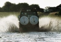 safari vehicle pass in the water
